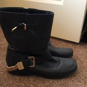 Guess black boots with gold buckles and chain